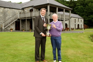 Seamus Leahy, Director of Marketing Fota Island Resort, presenting the Fota Island Junior Scratch Cup to Michael O'Driscoll. Picture: Niall O'Shea