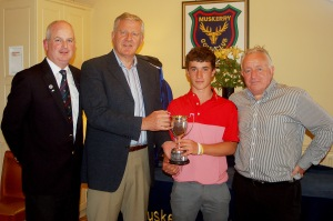 Sean Desmond (Monkstown) receiving the Bruen Youths Trophy from David Bruen, also included are David Taylor Captain Muskerry and Richard Cahill Sponsor.