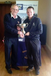 Conor Og Madigan receiving the Limerick Boys Trophy from Seamus Moloney, Vice-Captain Newcastlewest Golf Club.