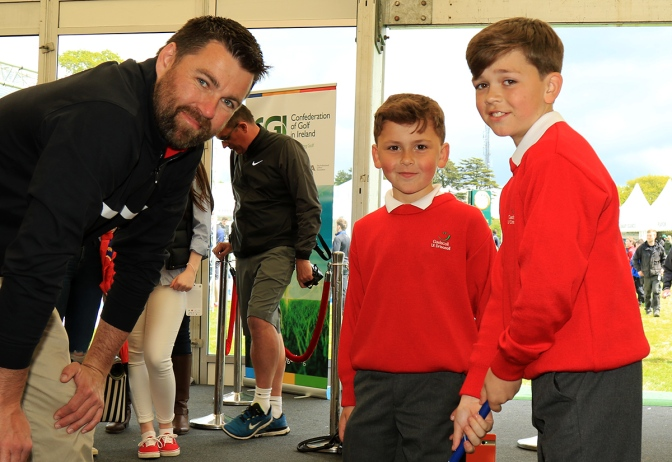 Cillian and Roty Long practicing with Coach Paul Henry at the CGI Interactive Zone at the Dubai Duty Free Irish Open. Picture: Niall O'Shea.