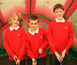 Gaelscoil Ui Drisceoil pupils Archie MacDomhnall, San Fergey and Fred Kehilly at the CGI Interactive Zone at the Dubai Duty Free Irish Open. Picture: Niall O'Shea