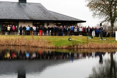 Seamus Power hitting a wedge back onto Monkstown's 18th fairway as the large crowd watches. Picture: Niall O'Shea