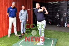John McSweeney from McGuirks trys out the new custom fitting bay at Frankfield Golf Academy, watched by resident PGA professionals David Whyte and Michael Ryan. Picture: Niall O'Shea
