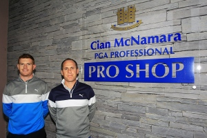 Shane Irwin pictured with Cian McNamara outside Monkstown Pro-Shop