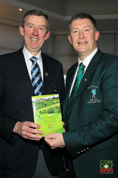 Jim Long, Chairman Munster Golf receives his copy of the 25th Anniversary book from Lee Valley Captain Brian O'Donovan. Picture: Niall O'Shea