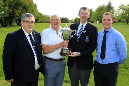 Billy Donlon (Birr) receiving the Munster Seniors trophy from Jim Long, Chairman Munster Golf. Also included are Bernard Hanrahan, Captain Ennis Golf Club and Patrick Treacy from Treacy's West County Hotel Ennis. Picture: Niall O'Shea