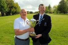 Billy Donlon (Birr) receiving the Munster Seniors Open trophy from Jim Long, Chairman Munster Golf. Picture: Niall O'Shea