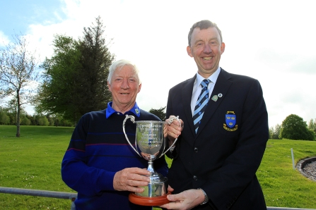 Maurice Kelly (Naas) receiving the Munster Veterans trophy from Jim Long, Chairman Munster Golf. Picture: Niall O'Shea