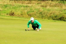 John Murphy getting his line right on the 1st green in Carton House at the opening day ofm the Eisenhower Trophy. Picture: Niall O'Shea