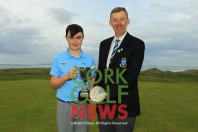 Adam Challoner (Galway Bay) receiving the Munster Boys Under 14 Trophy from Jim Long, Chairman Munster Golf. Picture: Niall O'Shea