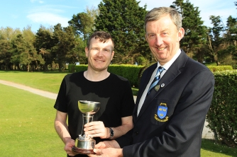 Kevin Purcell (Slievenamon) receiving the Munster Mid Am Trophy from Jim Long, Chairman Munster Golf. Picture: Niall O'Shea