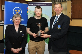 Kevin Purcell (Slievenamon) receiving the Munster Mid Am Trophy from Jim Long, Chairman Munster Golf. Also included is Ruth Hannigan, Lady Captain Gold Coast Golf Club Picture: Niall O'Shea