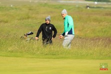 Mallow's Jame Sugrue and caddy Conor Dowling assessing their options from the rough during the first round of the Amateur Championship at Portmarnock. Picture: Niall O'Shea