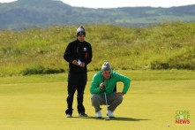Mallow's Jame Sugrue and caddy Conor Dowling checking the line during the first round of the Amateur Championship at Portmarnock. Picture: Niall O'Shea