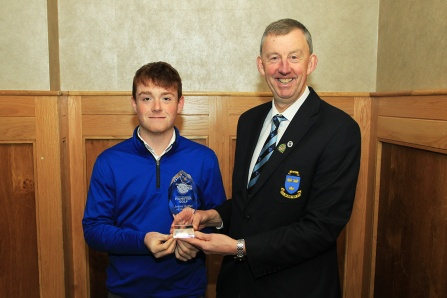 Fionn Hickey (Muskerry) being presented with the Munster Junior Golfer of the Year award from Jim Long, Chairman Munster Golf. Picture: Niall O'Shea