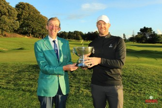 Munster Stroke Play winner Peter O'Keeffe receiving the Cork Scratch Cup from Jim Long, Chairman Munster Regional Executive Golf Ireland. Picture: Niall O'Shea.